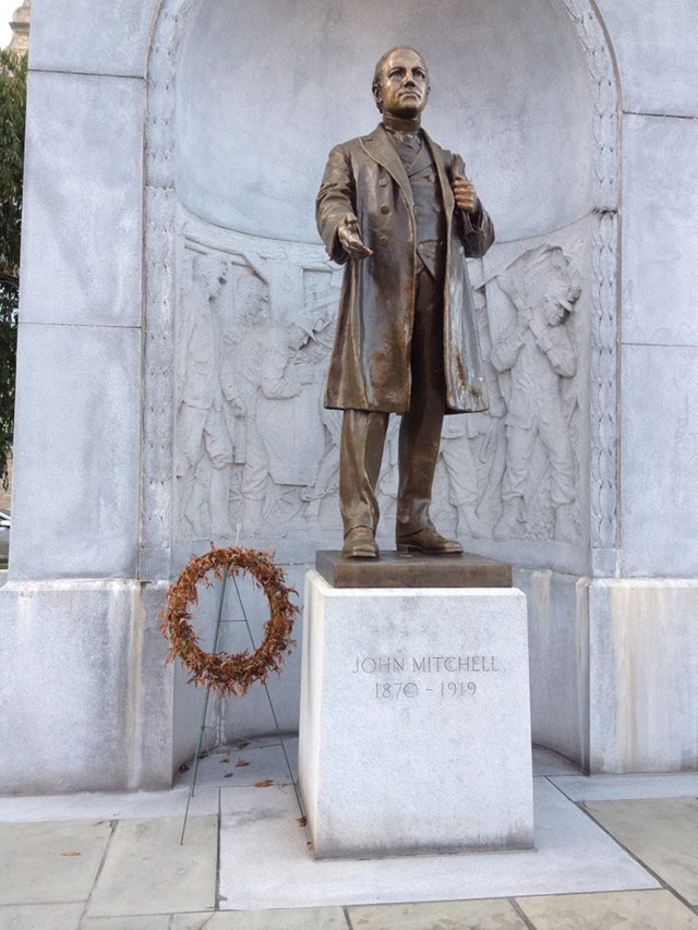 John Mitchell statue with dead wreath